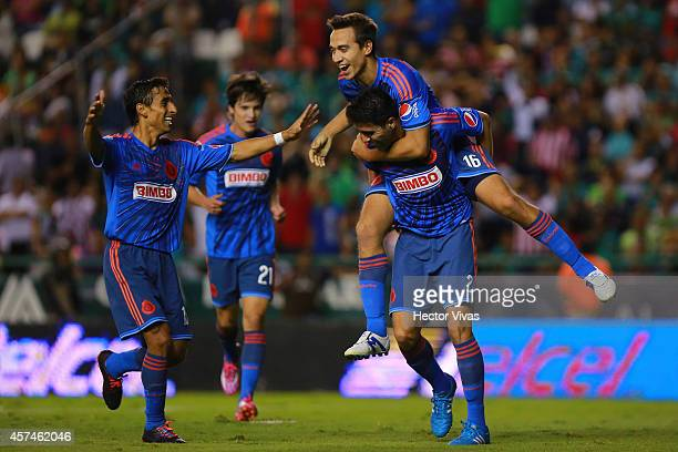 Nestor Vidrio of Chivas celebrates with teammates after scoring the first goal of his team during a match between Leon and Chivas as part of 13th...