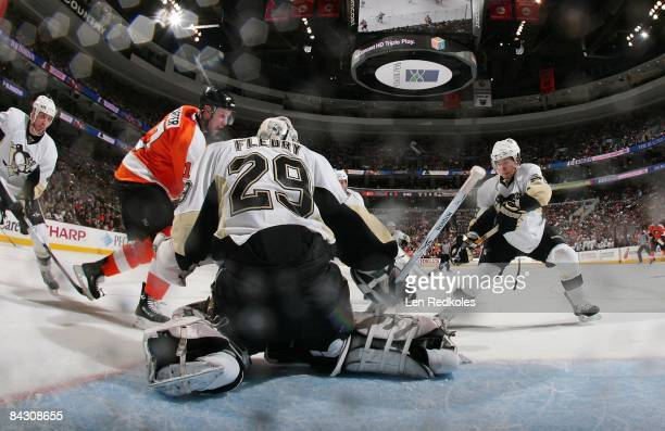 Net Cam view of Marc-Andre Fleury and Kris Letang of the Pittsburgh Penguins stopping a shot on goal by Jeff Carter of the Philadelphia Flyers on...