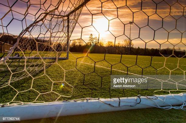 net on goalpost at sunset - goal post stock pictures, royalty-free photos & images