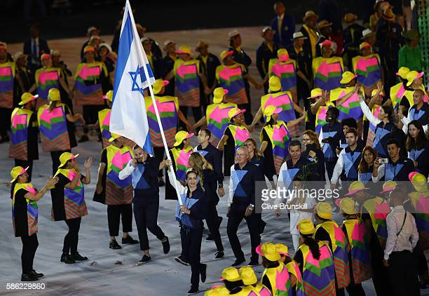 Neta Rivkin of Israel carries the flag during the Opening Ceremony of the Rio 2016 Olympic Games at Maracana Stadium on August 5 2016 in Rio de...