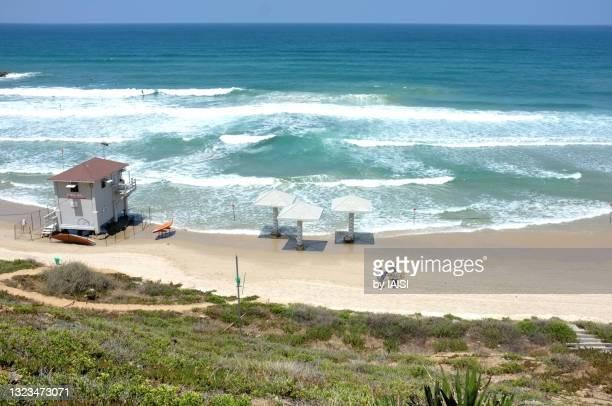 netanya seashore, surfers, lifeguard hut, high angle view - netanya stock pictures, royalty-free photos & images