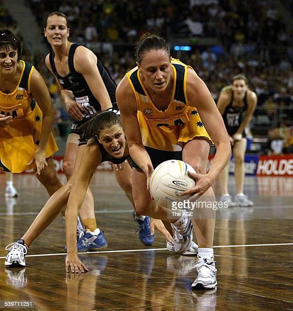Netball Australia v New Zealand Melbourne 3rd Test Australian Megan Anderson takes the ball in front of Anna Scarlett 20 November 2004 THE AGE SPORT...