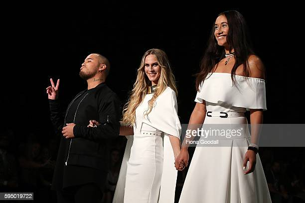 Netball Silver Fern Maria Tutaia with singer Stan Walker and designer Rochelle Goodrick showcases designs by Rochelle on the runway during 2016 New...