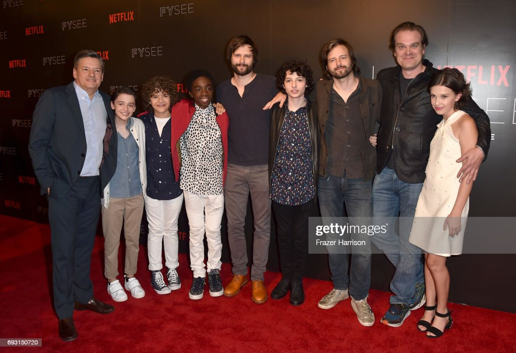 Netflix CCO Ted Sarandos, Noah Schnapp, Gaten Matarazzo, Caleb McLaughlin, writer/producer Matt Duffer, Finn Wolfhard, writer/producer Ross Duffer, David Harbour, and Millie Bobby Brown attend Netflix's 'Stranger Things' For Your Consideration event at Netflix FYSee Space on June 6, 2017 in Beverly Hills, California.