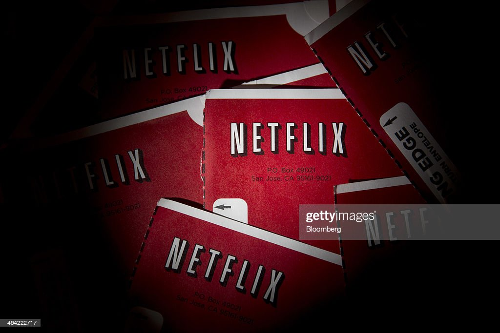 Netflix Inc. DVD mailers are arranged for a photograph in Washington, D.C., U.S., on Tuesday, Jan. 21, 2014. Netflix Inc., the largest subscription streaming service, is expected to release earnings data on Jan. 22. Photographer: Andrew Harrer/Bloomberg via Getty Images