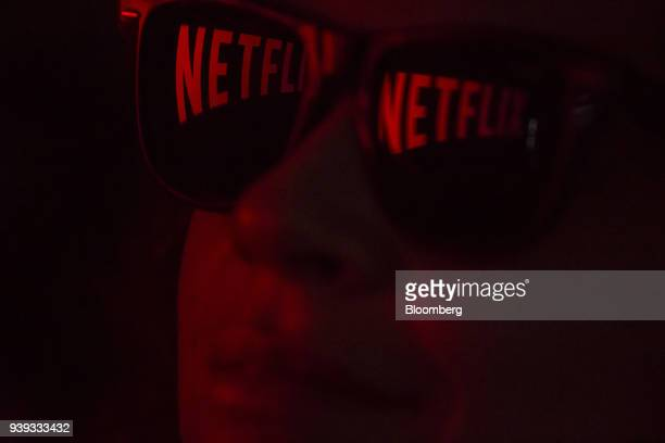 Netflix Inc signage is reflected on a pair of sunglasses in an arranged photograph taken in Sao Paulo Brazil on Wednesday March 28 2018 While the...