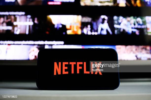 Netflix logo is seen displayed on phone screen in this illustration photo taken in Poland on July 17, 2020. On-Demand streaming services gained...