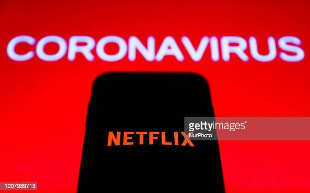 Netflix logo is seen on the smartphone screen with coronavirus sign in the background in this illustration photo taken in Poland on March 21 2020