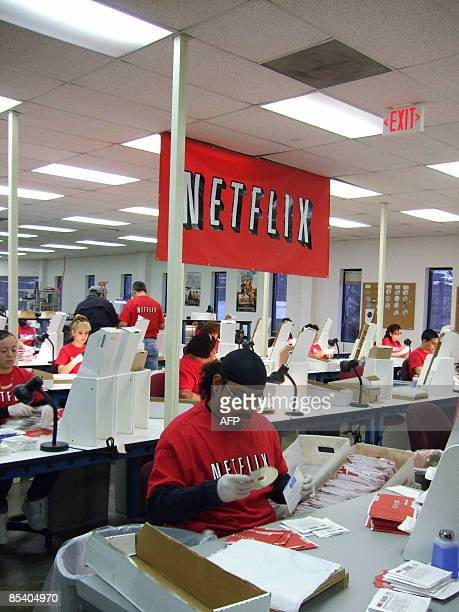 Netflix workers sort DVDs at the company's Piscataway, New Jersey, distribution center on March 10, 2009. AFP PHOTO / Marine LAOUCHEZ