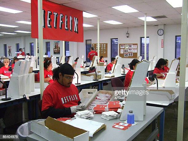 Netflix workers sort DVDs at the company's Piscataway New Jersey distribution center on March 10 2009 AFP PHOTO / Marine LAOUCHEZ