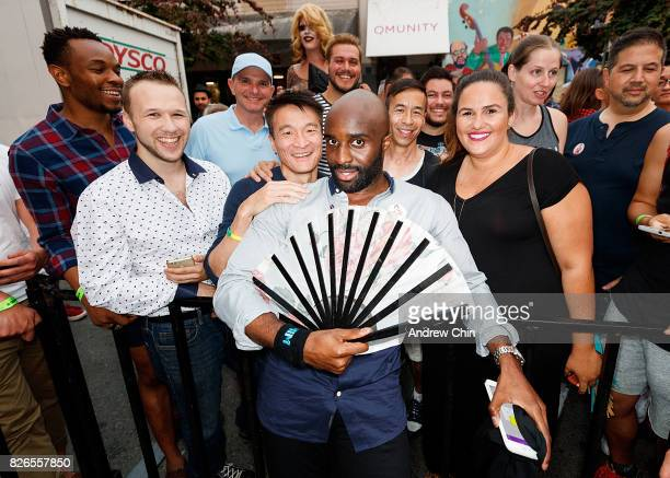 Netflix's Sense8 cast Toby Onwumere poses with fans during Davie Street Block Party on August 4 2017 in Vancouver Canada