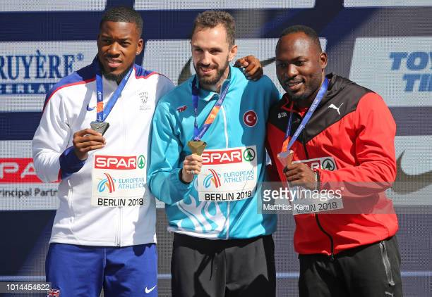 Nethaneel Mitchell Blake of Great Britain silver Ramil Guliyev of Turkey gold and Alex Wilson of Switzerland bronze pose with their medals for the...