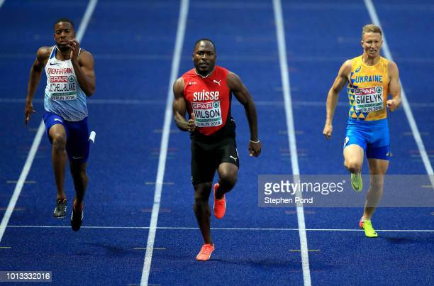 Nethaneel MitchellBlake of Great Britain Alex Wilson of Switzerland and Serhiy Smelyk of Ukraine compete in the Men's 200m SemiFinal during day two...