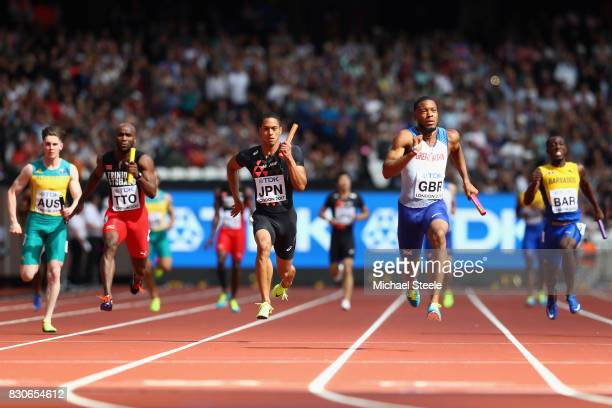 Nethaneel MitchellBlake of Great Britain and Aska Cambridge of Japan compete in the Men's 4x100 Metres Relay heats during day nine of the 16th IAAF...
