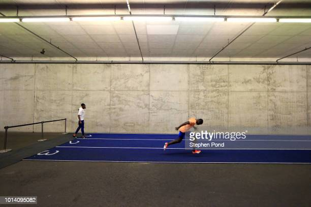 Nethaneel MitchellBlake of Great Britain and Solomon Bockarie of Netherlands prepare on the warm up track ahead of competing in the Men's 200m final...