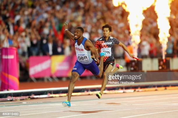 Nethaneel MitchellBlake of Great Britain crosses the finishline to win gold in the Men's 4x100 Relay final during day nine of the 16th IAAF World...