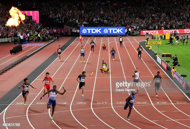 Nethaneel MitchellBlake of Great Britain crosses the finishline to win gold ahead of Christian Coleman of the United States in the Men's 4x100 Relay...