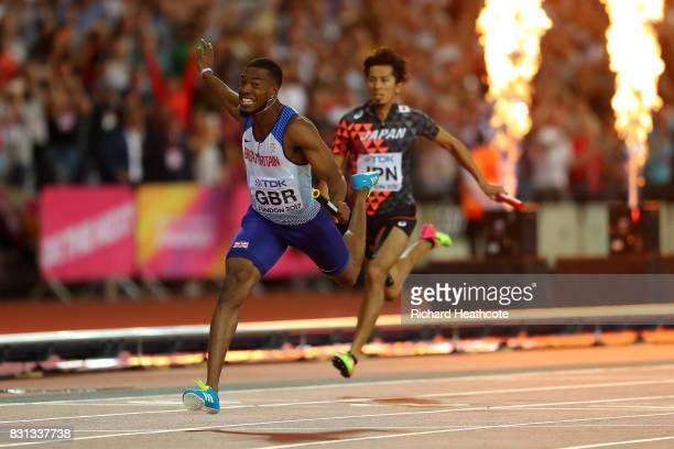 Nethaneel MitchellBlake of Great Britain crosses the finishline to win gold ahead of Kenji Fujimitsu of Japan bronze in the Men's 4x100 Relay final...