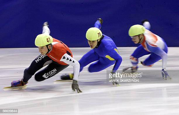 Netheland's Niels Kerstholt Ukrainian's Volodymyr Grygoriev and France's Maxime Chataignier compete during Men's 500m preliminary race 21 January...