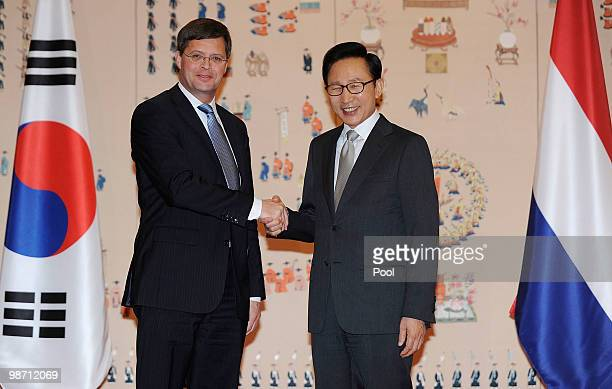 Netherands Prime Minister Jan Peter Balkenende shakes hands with South Korean President Lee MyungBak prior to the summit meeting at presidential...
