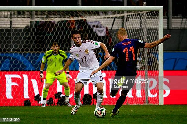 Netherland Robben and Spains's Azpilicueta and Iker Casillas at the 2014 World Cup match between Spain and Netherlands in Salvador Brasil this friday...