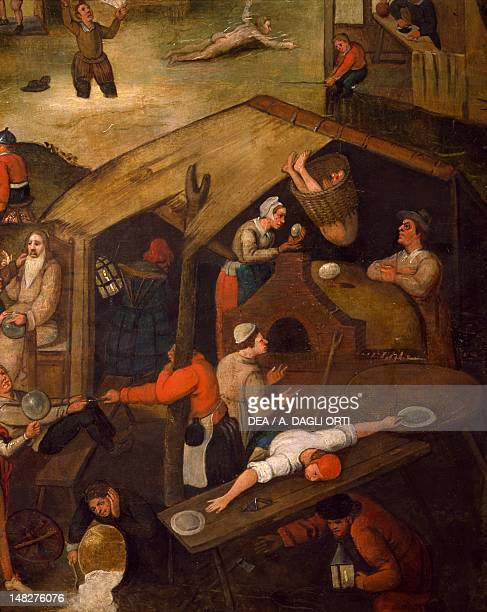 Netherlandish Proverbs by Pieter Brueghel the Elder oil on canvas 117x163 cm Aquisgrana Suermondt Ludwig Museum