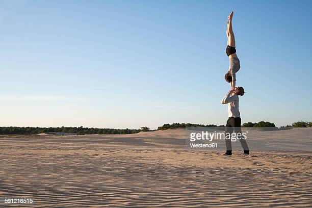 Netherlands, Acrobat couple performing hand to hand stands