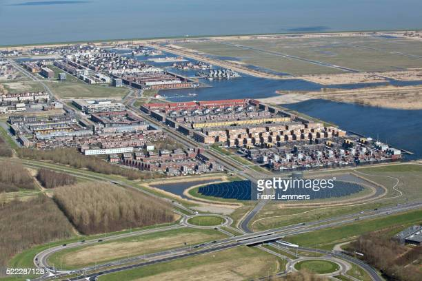 netherlands, almere, nuon solar island - almere stock pictures, royalty-free photos & images