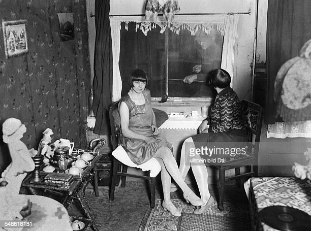 Netherlands Amsterdam Amsterdam: Prostitution, two prostitutes sitting at the window of thier room - 1929 - Photographer: Frankl - Published by: 'Der...