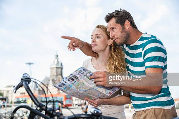 Netherlands, Amsterdam, couple with map looking for direction