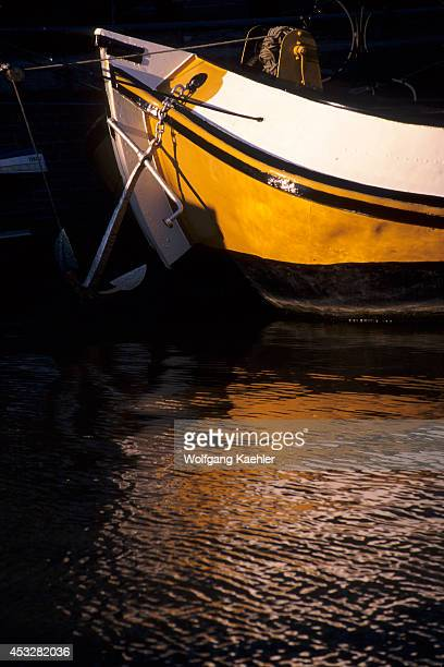 Netherlands Amsterdam Gracht Bow Of Boat In Evening Light