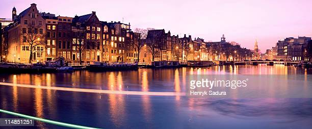 Netherlands, Amsterdam, Illuminated buildings by canal