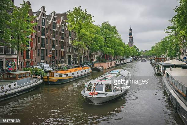 netherlands, amsterdam, prince's canal, tourist boat - tourboat stock pictures, royalty-free photos & images