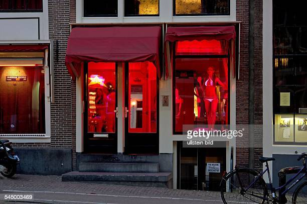 red light district at night prostitute at the window