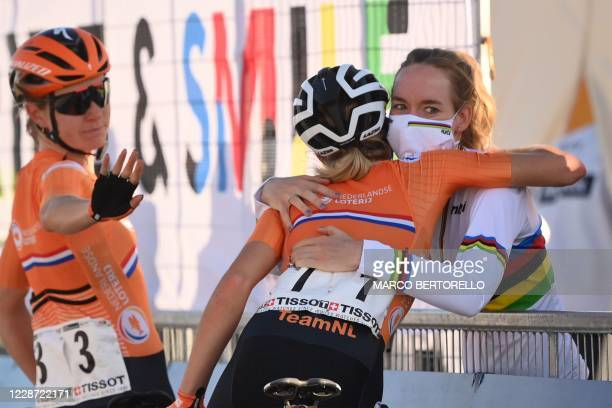 Netherlands' Amy Pieters and Netherlands' Demi Vollering congratulate Netherlands' Anna van der Breggen after she won the Women's Elite Road Race, a...