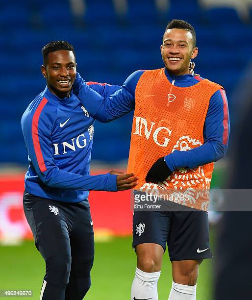 Netherlands and Manchester United player Memphis Depay shares a joke with Aeljero Elia during the Netherlands open training session ahead of their...