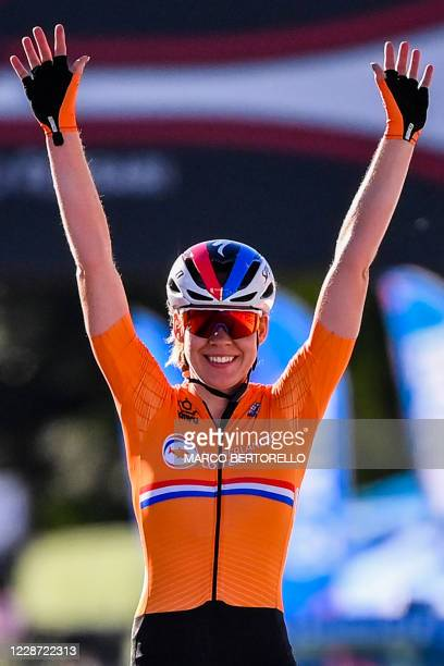 Netherlands' Anna van der Breggen celebrates as she crosses the finish line to win the Women's Elite Road Race, a 143-kilometer route around Imola,...