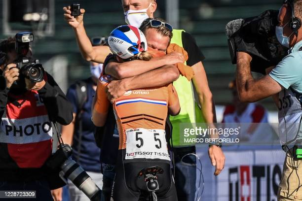 Netherlands' Anna van der Breggen embraces a relative after crossing the finish line to win the Women's Elite Road Race, a 143-kilometer route around...