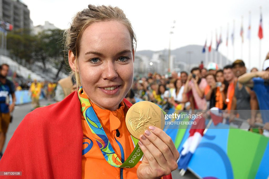 Netherlands' Anna Van Der Breggen poses with her gold medal after winning the Women's road cycling race at the Rio 2016 Olympic Games in Rio de Janeiro on August 7, 2016. / AFP / Eric FEFERBERG
