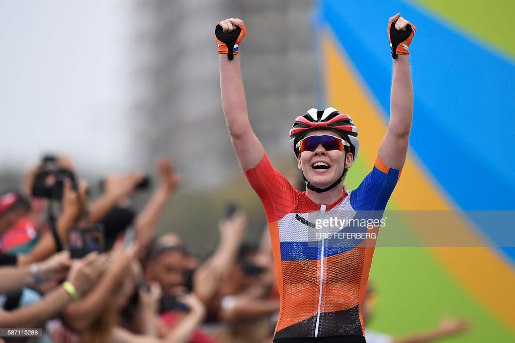 Netherlands' Anna Van Der Breggen reacts after winning the Women's road cycling race at the Rio 2016 Olympic Games in Rio de Janeiro on August 7, 2016. / AFP / Eric FEFERBERG