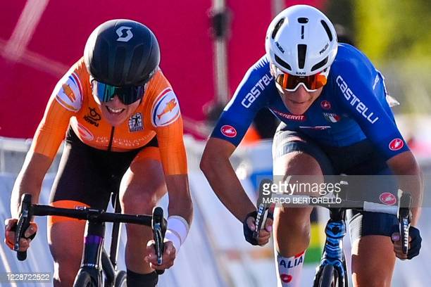 Netherlands' Annemiek van Vleuten and Italy's Elisa Longo Borghini sprint to cross the finish line and respectively place second and third of the...