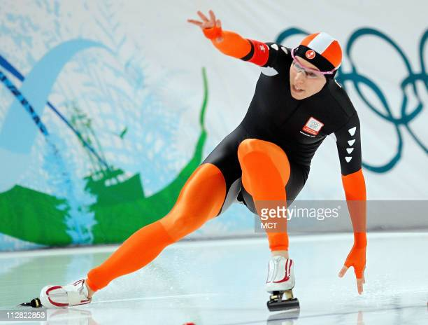 Netherland's Annette Gerritsen falls while competing in the 500 Meter Ladies Speed Skating event during the 2010 Winter Olympics in Vancouver British...