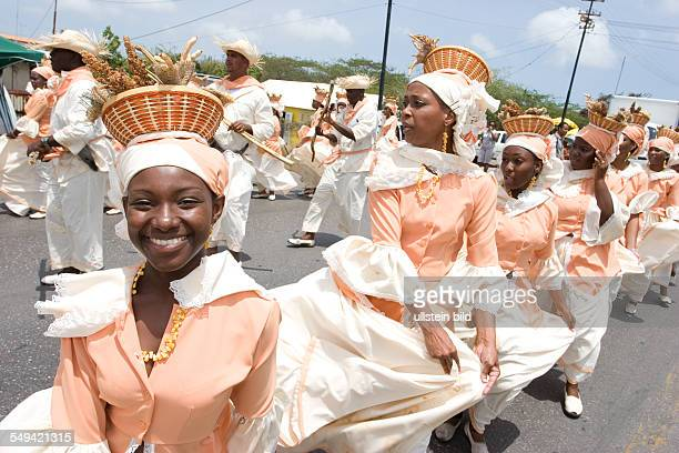 Netherlands Antills, Curacao, Willemstad, harvest festival, several groups in traditional clothing during a parade