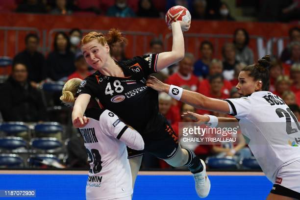 TOPSHOT Netherlands' Antje Lauenroth and Emily Bolk vies for the ball with Germany's Dione Housheer during the Main Round group 1 match between...