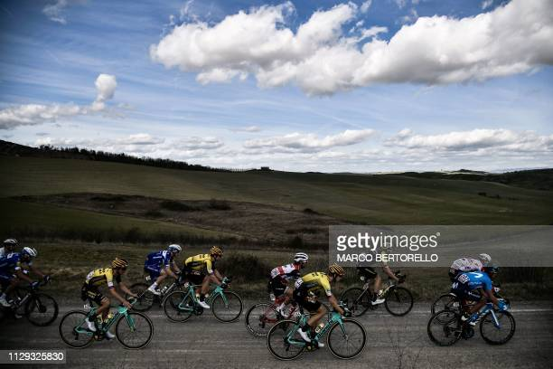 Netherlands' Antwan Tolhoek , Lennard Hofstede , Portugal's Nelson Oliveira and others ride during the one-day classic cycling race Strade Bianche on...