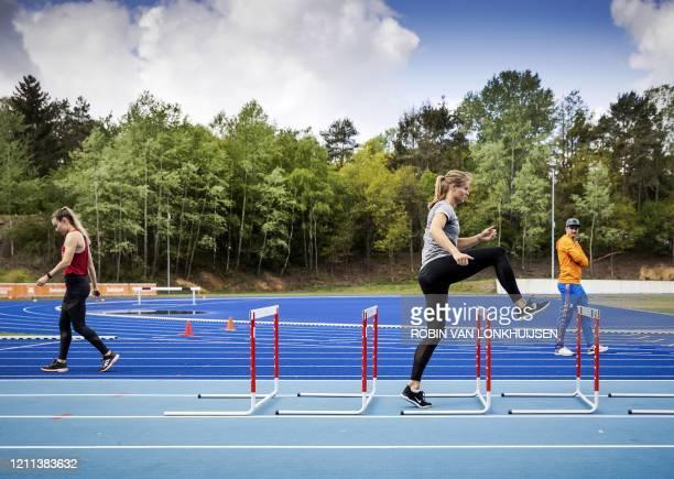 Netherlands' athletes Nadine Visser and Dafne Schippers take part in a training session at Papendal Sports Centre in Arnhem, The Netherlands on April...