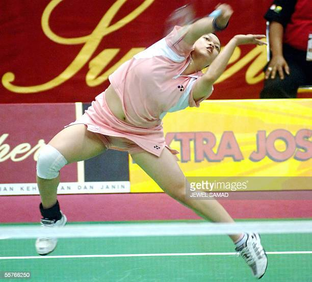 Netherlands badminton player Mia Audina returns the shuttle cock to her Hong Kong's opponent Chen Wang duringthe women's single final of the...