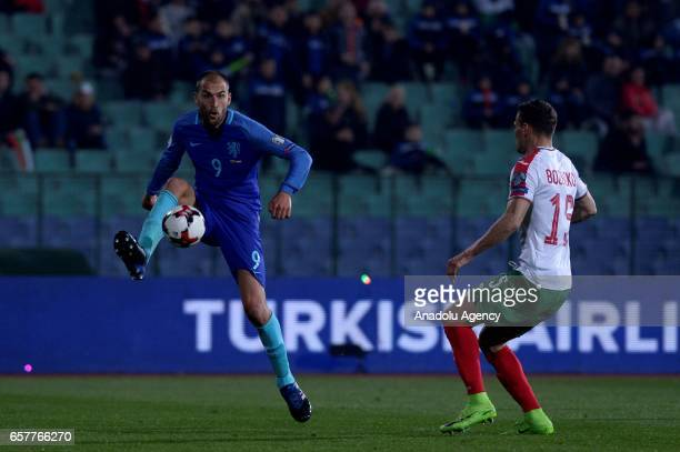 Netherlands Bas Dost vies for the ball against Vasil Bozhikov from Bulgaria during their FIFA World Cup 2018 Group A qualifying soccer match between...