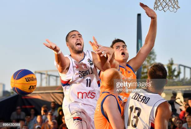 Netherlands' Bas Rozendaal vies with Serbia's Dusan Domovic Bulutt during the basketball 3x3 world championships final against Netherlands on June 21...