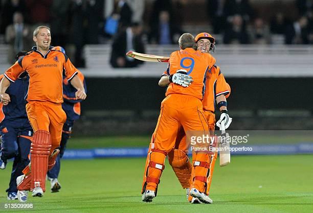Netherlands batsmen Edgar Schiferli and Ryan ten Doeschate celebrate as Daan van Bunge runs on to congratulate them after winning the ICC World...